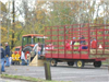Children loading into trailer preparing for hay ride