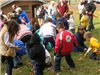 Children picking up candy during candy hunt