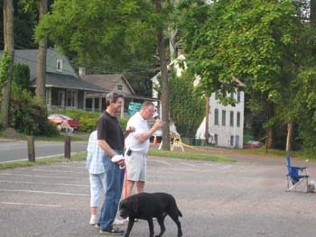 People and Dog in Parking Lot