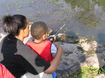 Mom helping son fish (PDF)