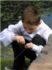 Child baits his fishing hook