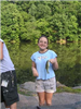 Girl in blue shirt holds the fish she caught