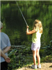 Young girl reels in fish (PDF)